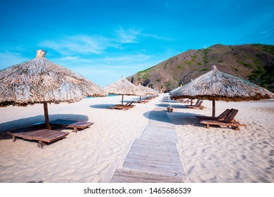 beach with umbrellas made of tree leaves at Ky Co, Quy Nhon city  - Shutterstock ID 1465686539