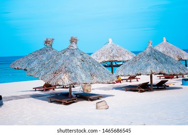 beach with umbrellas made of tree leaves at Ky Co, Quy Nhon city  - Shutterstock ID 1465686545