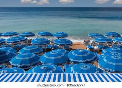 Beach umbrellas on the Cote d' Azur, Nice, France