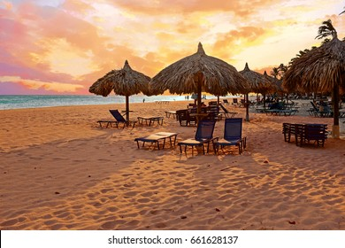 Beach umbrella's on Druif beach at Aruba island in the Caribbean at sunset
