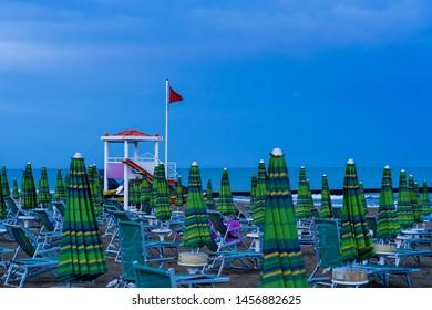 Beach umbrellas on Jesolo beach in Venetian area, Italy.