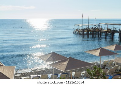 Beach umbrellas on the Mediterranean Sea in Kemer, Turkey