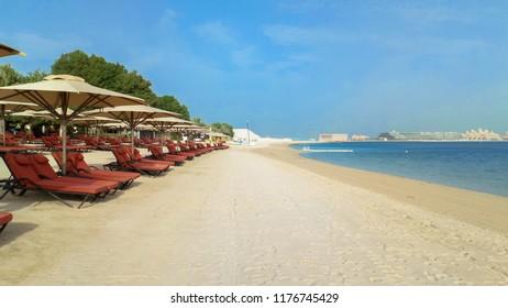 Beach with umbrellas in Ras al Khaimah. UAE. September 2018