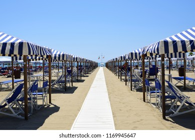 Beach with beach umbrellas in Versilia. Viareggio, Tuscany, Italy