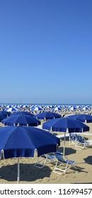 Beach with beach umbrellas in Versilia. Viareggio, Tuscany, Italy