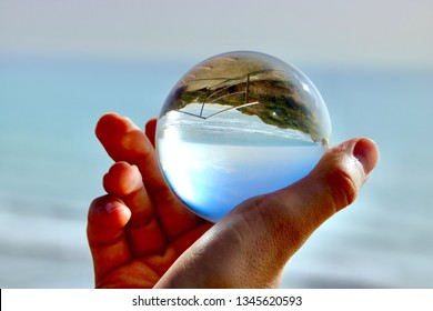 Beach upside down in a crystal ball.