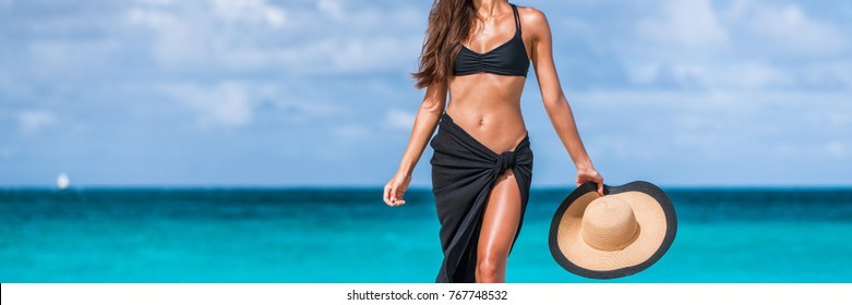 Beach vacation bikini body fashion woman banner. Stomach and slim waistline weight loss suntan girl. Luxury travel skin care panorama copy space crop.
