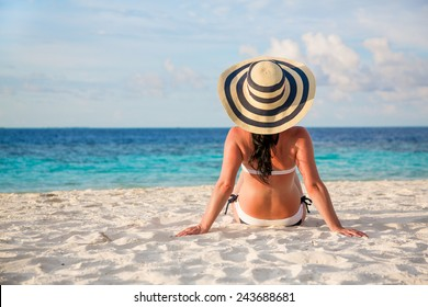 Beach vacation. Girl and tropical beach in the Maldives.