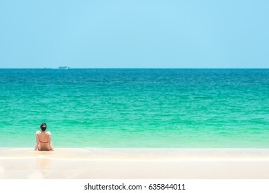 Beach vacation - Woman enjoy relaxing on the beach in Thailand