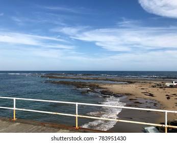 A beach in Victoria, Australia, as seen from the pier.