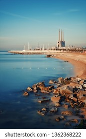 Beach view in Barcelona with city architecture in Spain