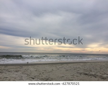 https://image.shutterstock.com/image-photo/beach-view-gray-clouds-yellow-450w-627870521.jpg