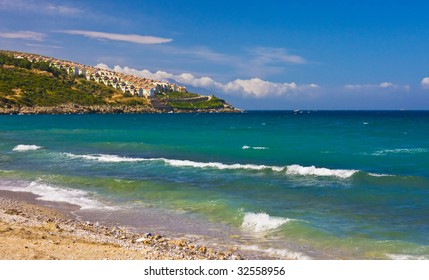 Beach view of hill with many houses, Kusadasi, Turkey