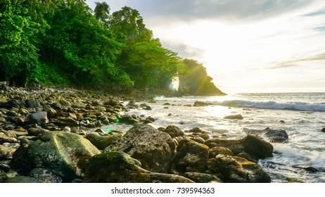 Beach view with lots of rocks at Gua Sarang Iboih Sabang Island Indonesia