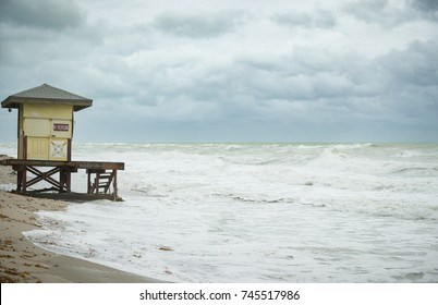 Beach view with waves. Morning on the ocean or sea beach. Lifeguard house.