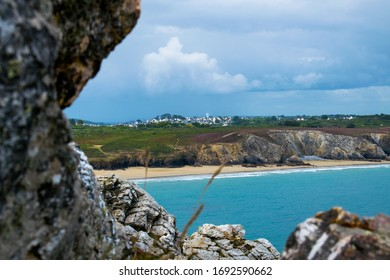 Beach with a village in background, Bretagne, France