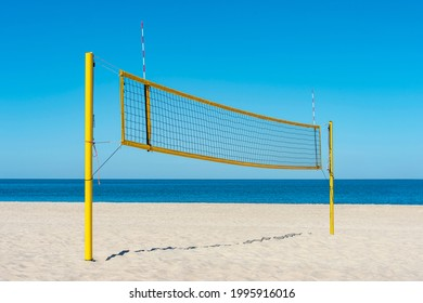 Beach volleyball court with an ocean background. Summer sport concept
