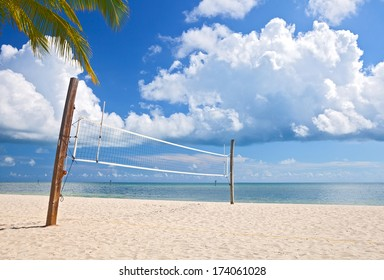 Beach volleyball court on a beautiful summer day in Florida with ocean and blue cloudy sky