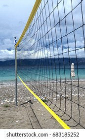 beach volleyball net on cloudy sky and sea  bacgkround