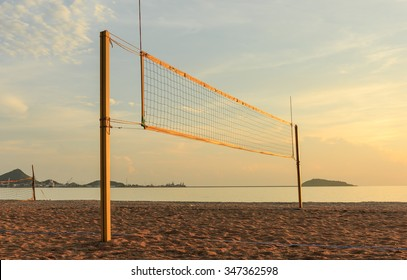 beach volleyball  net on sandy beach in the evening time