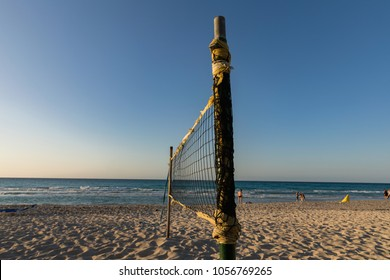 Beach volleyball net on Varadero Beach in the evening sun. Beautiful tropical beach of Varadero in Cuba, turquoise ocean