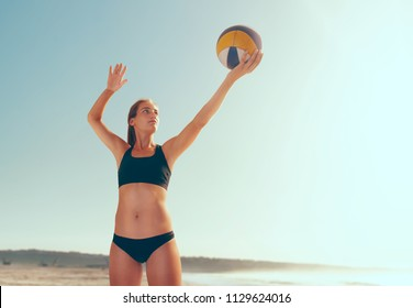 Beach volleyball on sunset