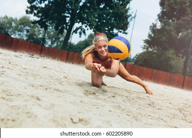 Beach volleyball, people outdoors.