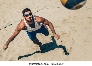 Beach volleyball Player about to hit the ball