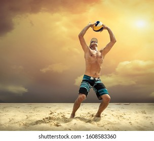 Beach volleyball player in action at sunny day under yellow sky.