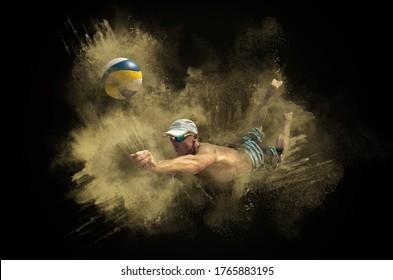 Beach volleyball player in action at sunny day around splash of sand on dark background.