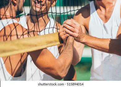 Beach volleyball players after match congradulating each other