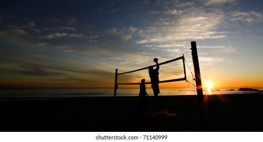 beach volleyball practice at sunset