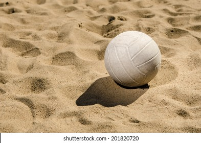 Beach volleyball in sand
