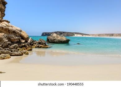 Beach at Wadi Darbat with cliffs, Taqah (Oman)