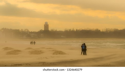 beach walking in strong sand storm windy weather