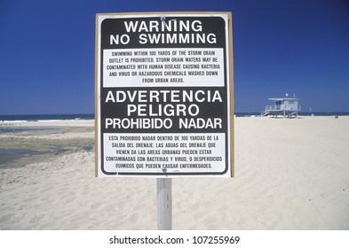 A beach warning sign in Santa Monica