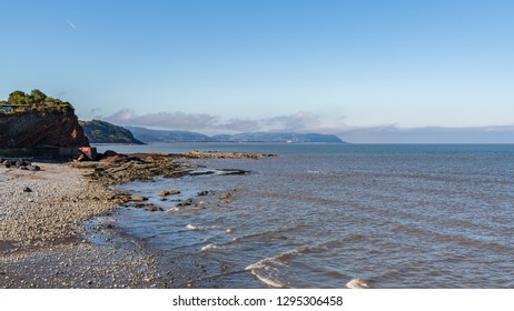 The beach in Watchet, Somerset, England, UK - with Minehead in the background
