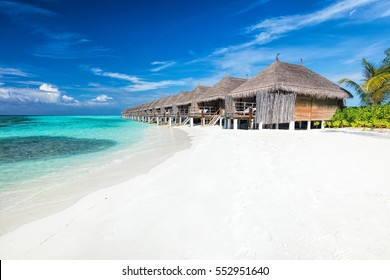 Beach and water villas on a small island resort in Maldives, Indian Ocean. Holidays destination