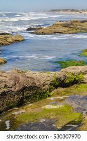 Beach, waves and rocks at Torres beach