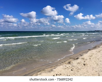 Beach, waves, sky with clouds