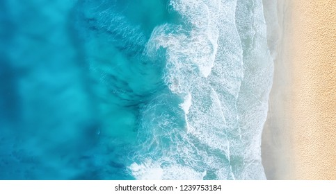 Beach and waves from top view. Turquoise water background from top view. Summer seascape from air. Top view from drone. Travel concept and idea - Shutterstock ID 1239753184