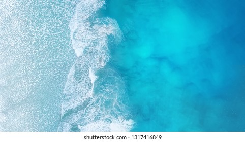 Beach and waves from top view. Turquoise water background from top view. Summer seascape from air. Top view from drone. Travel - image