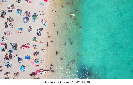 Beach and waves from top view. Turquoise water background from top view. Summer seascape from air. Top view from drone. Travel-image