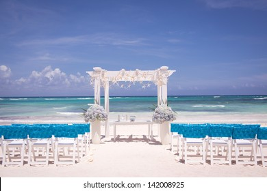 Beach Wedding Ceremony with Blue Water