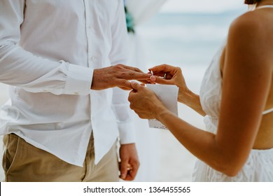 beach wedding ceremony with vows and ring exchange