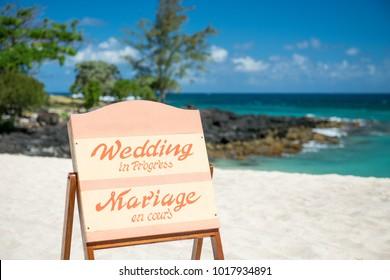beach wedding sign on a beach