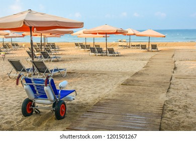 Beach wheel chair for disabled swimmers near The Mediterranean sea in hotel. Resort - vacation concept.  Summer holidays.  Outdoor activities on the beach in summer.