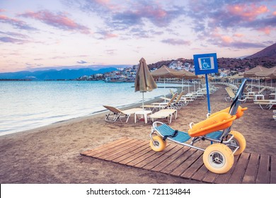 Beach wheel chair for disabled swimmers, Elounda, Crete, Greece.