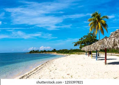 Beach with white sand and translucent turquoise blue water on caribbean island, Ancon Beach, Cuba