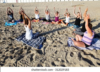 beach yoga group in the sand